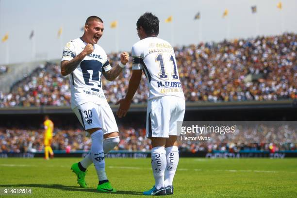 Matias Alustiza of Pumas celebrates with teammate Nicolas Castillo after scoring the second goal of his team during the 5th round match between Pumas...