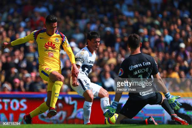 Matias Alustiza of Pumas struggles for the ball with Edson Alvarez and Agustin Marchesin goalkeeper of America during the 3rd round match between...