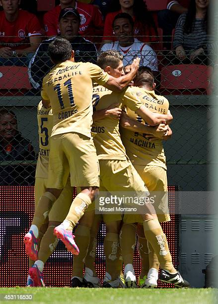 Matias Britos of Pumas and his teammates celebrate after scoringthe opening goal against Toluca during a match between Toluca and Pumas as part of...