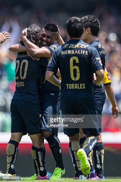 Matias Britos of Pumas celebrates after scoring the second goal of his team with his teammate Daniel Ludue–a during a match between Pumas UNAM and...