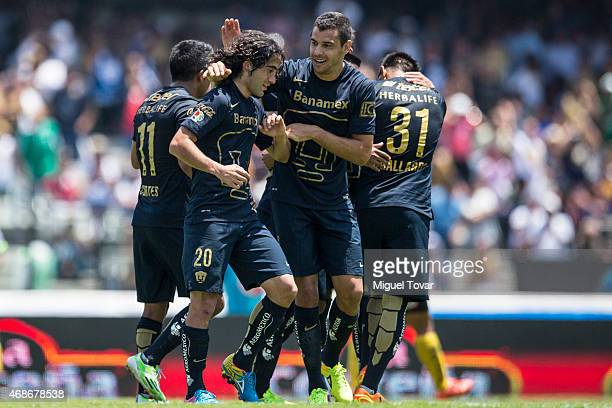 Matias Britos of Pumas celebrates after scoring with his teammate Gerardo Alcoba during a match between Pumas UNAM and Leones Negros as part of 12th...