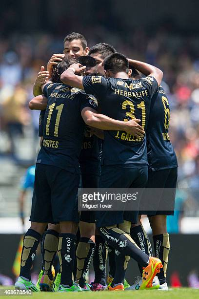 Matias Britos of Pumas celebrates with his teammates after scoring the second goal of his team during a match between Pumas UNAM and Leones Negros as...