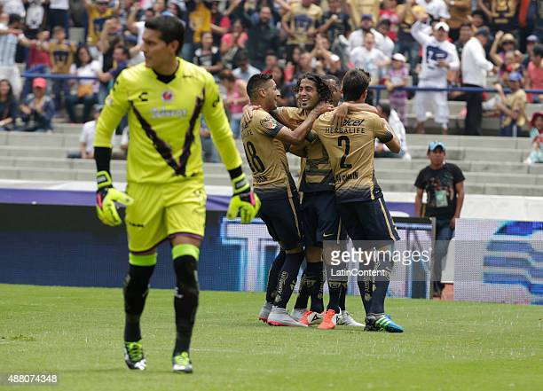 Matias Britos of Pumas celebrates with his teammates after scoring the second goal of his team during a 8th round match between Pumas UNAM and...