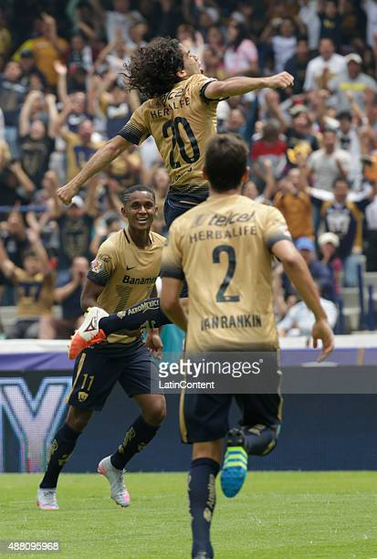 Matias Britos of Pumas celebrates with his teammates after scoring the second goal of his team during an 8th round match between Pumas UNAM and...