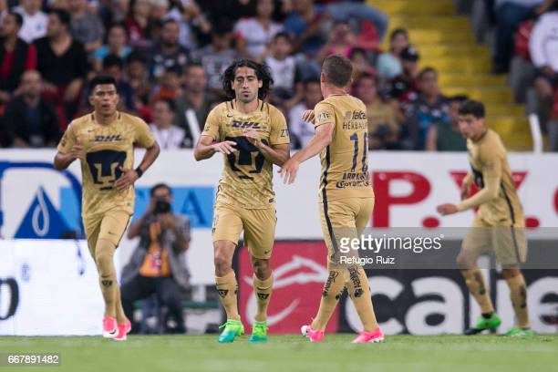 Matias Britos of Pumas celebrates with his teammates after scoring the tying goal of his team during the 10th round match between Atlas and Pumas...