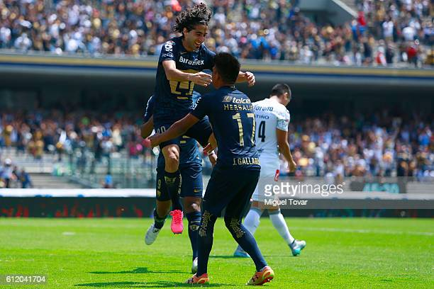 Matias Britos of Pumas celebrates with teammates after scoring during the 12th round match between Pumas UNAM and Chiapas as part of the Torneo...