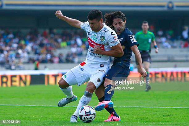 Matias Britos of Pumas fights for the ball with Juan Patino of Jaguares during the 12th round match between Pumas UNAM and Chiapas as part of the...
