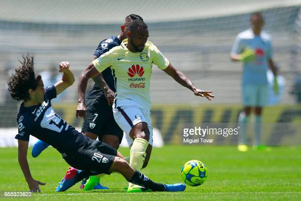 Matias Britos of Pumas fights for the ball with William Da Silva of America during the 11st round match between Pumas UNAM and America as par of the...