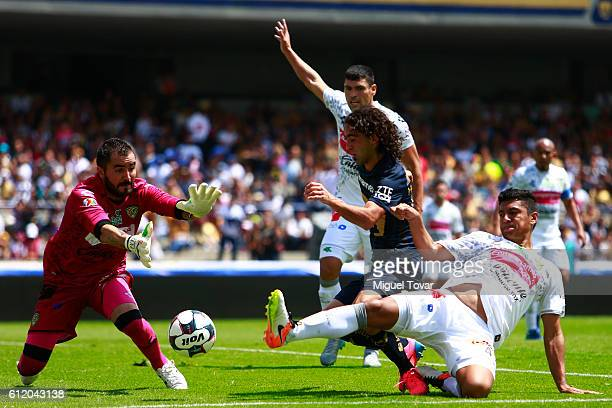 Matias Britos of Pumas tries to score past Liborio Sanchez and Juan Patino of Jaguares during the 12th round match between Pumas UNAM and Chiapas as...