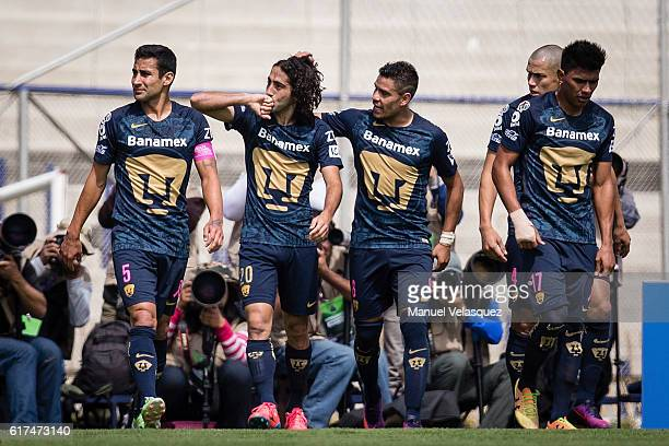Matias Britos of Pumas UNAM celebrates with teammates after scoring a goal during a match between Pumas UNAM and Tigres UANL as part of the Apertura...