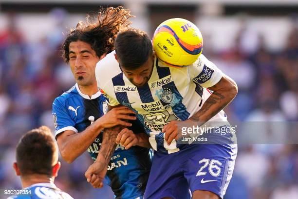 Matias Britos of Queretaro defends against Robert Herrera of Pachuca during the 16th round match between Queretaro and Pachuca as part of the Torneo...