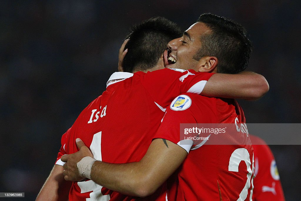 Matias Campos Toro (R), from Chile, celebrates his goal against Paraguay, during the match between Chile and Paraguay as part of the South American Qualifiers for Brazil 2014 FIFA World Cup on November 15, 2011 in Santiago, Chile.