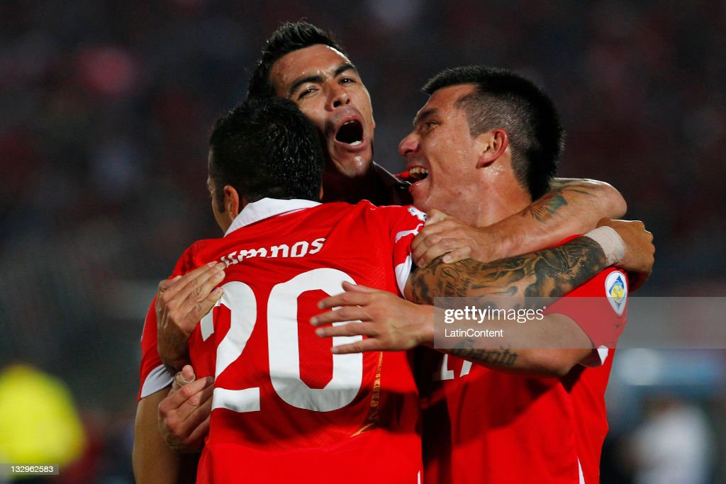 Matias Campos Toro (L), from Chile, celebrates his goal aganist Paraguay, during the match between Chile and Paraguay as part of the South American Qualifiers for Brazil 2014 FIFA World Cup on November 15, 2011 in Santiago, Chile.