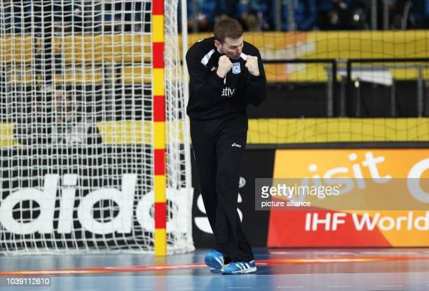 Matias Carlos Schulz of Argentina celebrates a parade during the men's Handball World Championships main round match Argentina vs Tunisia in...