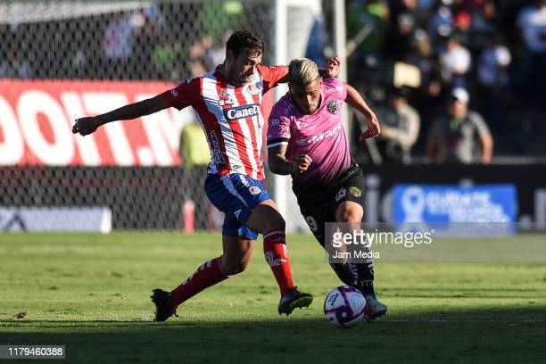 Matias Catalan of San Luis fights for the ball with Gabriel Hachen of Juarez during the 13th round match between FC Juarez and Atletico San Luis as...