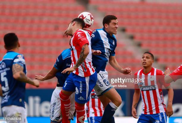 Matias Catalan of San Luis fights for the ball with Santiago Orvelle of Puebla during the 10th round match between Atletico San Luis and Puebla as...