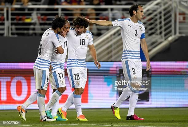 Matias Corujo of Uruguay is congratulated by teammates Nicolas Lodeiro Diego Godin and Egidio Arevalo after Corujo scored a goal against Jamaica...