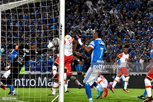 Matias dos santos of Millonarios scores the first goal of his team during the first leg match between Millonarios and Independiente Santa Fe as part...