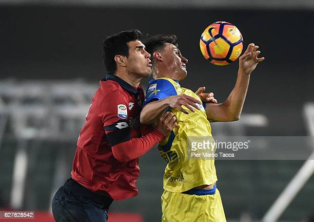 Matias Ezequiel Munoz of Genoa CFC competes for the ball with Roberto Inglese of AC ChievoVerona during the Serie A match between AC ChievoVerona and...