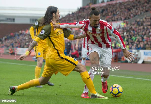 Matias Ezequiel Schelotto of Brighton and Hove Albion and Maxim ChoupoMoting of Stoke City battle for the ball during the Premier League match...