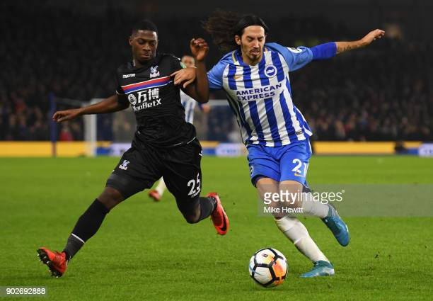 Matias Ezequiel Schelotto of Brighton and Hove Albion and Sullay Kaikai of Crystal Palace battle for the ball during The Emirates FA Cup Third Round...