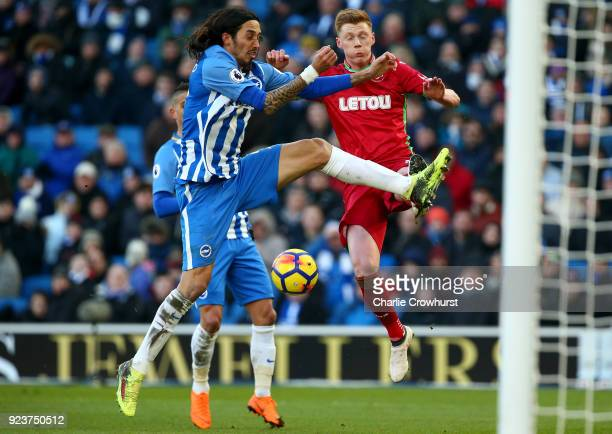 Matias Ezequiel Schelotto of Brighton and Hove Albion competes for the ball with Samuel Clucas of Swansea City during the Premier League match...