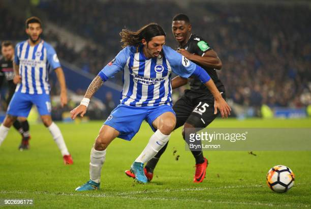Matias Ezequiel Schelotto of Brighton and Hove Albion evades Sullay Kaikai of Crystal Palace during The Emirates FA Cup Third Round match between...