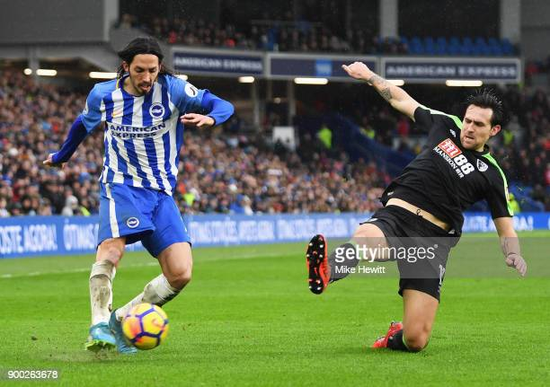 Matias Ezequiel Schelotto of Brighton and Hove Albion is closed down by Charlie Daniels of AFC Bournemouth during the Premier League match between...