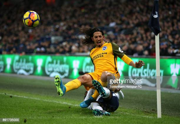 Matias Ezequiel Schelotto of Brighton and Hove Albion is fouled by Danny Rose of Tottenham Hotspur during the Premier League match between Tottenham...