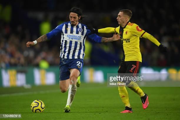 Matias Ezequiel Schelotto of Brighton Hove Albion is challenged by Gerard Deulofeu of Watford during the Premier League match between Brighton Hove...