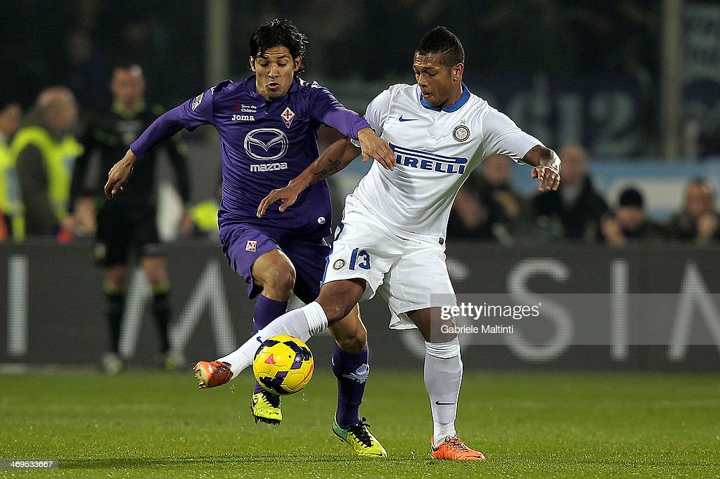 Matias Fernandez of ACF Fiorentina fights for the ball with Fredy Guarin of FC Internazionale Milano during the Serie A match between ACF Fiorentina and FC Internazionale Milano at Stadio Artemio Franchi on February 15, 2014 in Florence, Italy.