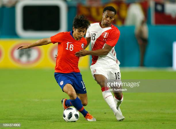 Matias Fernandez of Chile and André Carrillo of Peru battle for control of the ball during an International friendly match on October 12 2018 at Hard...