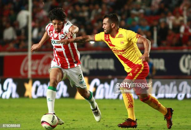 Matias Fernandez of Necaxa and Mario Osuna of Morelia fight for the ball during the 17th round match between Morelia and Necaxa as part of the Torneo...