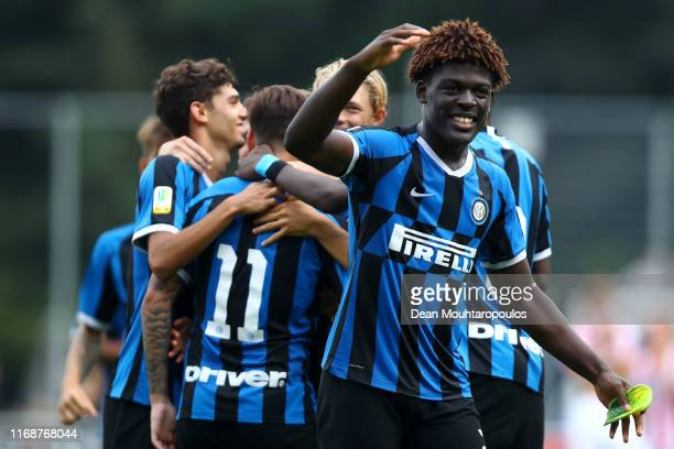 Matias Fonseca of Inter is congratulated by team mates Lorenzo Colombini, Chrystopher Attys, Etienne Ludovic Youte Kinkoue and Elvis Rikard Lindkvist...