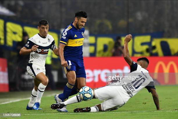 Matias Garcia of Gimnasia y Esgrima La Plata challenges Eduardo Salvio of Boca Juniors during a match between Boca Juniors and Gimnasia as part of...