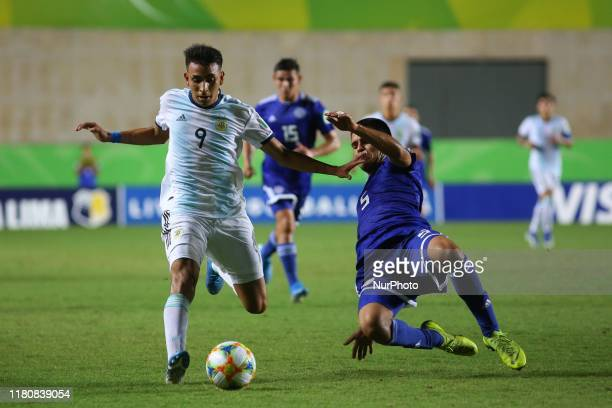 Matias Godoy of Argentina and and Rolando Ortiz of Paraguay fight for the ball during the FIFA U17 World Cup Brazil 2019 round of 16 match between...