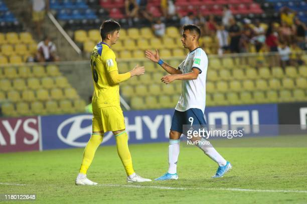 Matias Godoy of Argentina and Shohrukh Qirghizboev of Tajikistan up after a goal was scored against him during the FIFA U17 World Cup Brazil 2019...