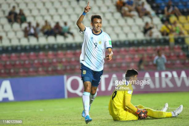 Matias Godoy of Argentina celebrates in front of Shohrukh Qirghizboev of Tajikistan after scoring a goal during the FIFA U17 World Cup Brazil 2019...