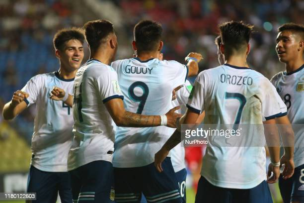 Matias Godoy of Argentina celebrates with teammates after scoring a goal during the FIFA U17 World Cup Brazil 2019 Group E match between Argentina...