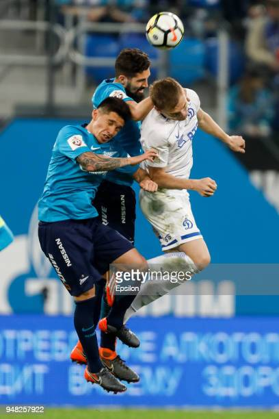 Matias Kranevitter and Miha Mevlja of FC Zenit Saint Petersburg vie for the ball with Yevgeni Lutsenko of FC Dinamo Moscow during the Russian...