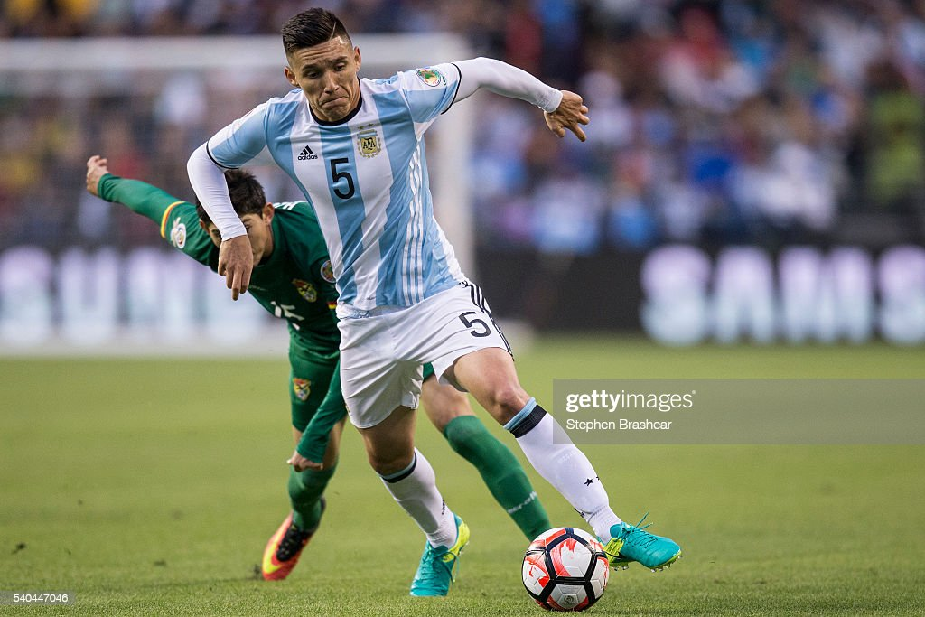 Matias Kranevitter, of Argentina dribbles the ball as Pedro Azogue of Bolivia defends during a group D match between Argentina and Bolivia at CenturyLink Field as part of Copa America Centenario US 2016 on June 14, 2016 in Seattle, Washington, US.