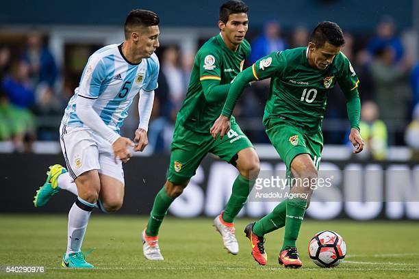 Matias Kranevitter of Argentina struggles for the ball against Jhasmany Campos of Bolivia during the 2016 Copa America Centenario Group D match...