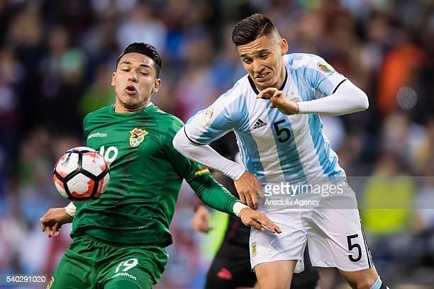 Matias Kranevitter of Argentina struggles for the ball against Carmelo Algarasaz of Bolivia during the 2016 Copa America Centenario Group D match...