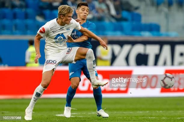 Matias Kranevitter of FC Zenit Saint Petersburg and Erling Braut Haland of Molde FK vie for the ball during the UEFA Europa League playoffs first leg...