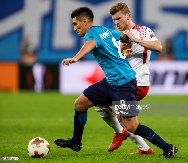 Matias Kranevitter of FC Zenit Saint Petersburg and Timo Werner of RB Leipzig vie for the ball during the UEFA Europa League Round of 16 second leg...