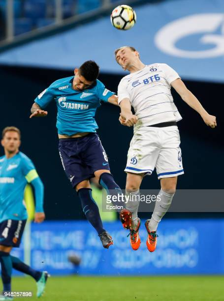 Matias Kranevitter of FC Zenit Saint Petersburg and Yevgeni Lutsenko of FC Dinamo Moscow vie for a header during the Russian Football League match...