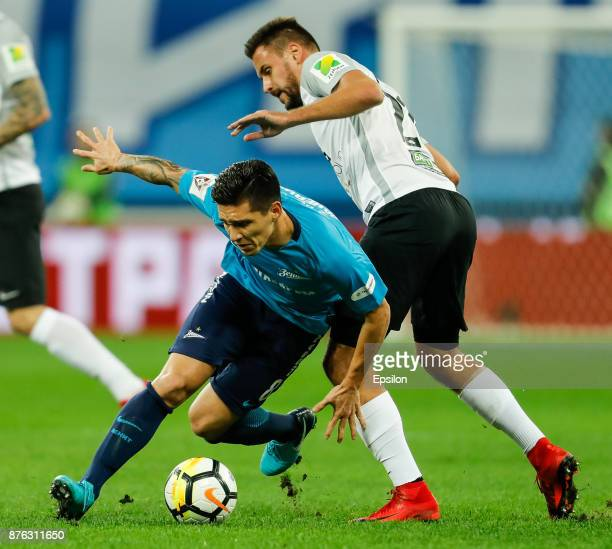 Matias Kranevitter of FC Zenit Saint Petersburg and Yevgeni Markov of FC Tosno vie for the ball during the Russian Football League match between FC...
