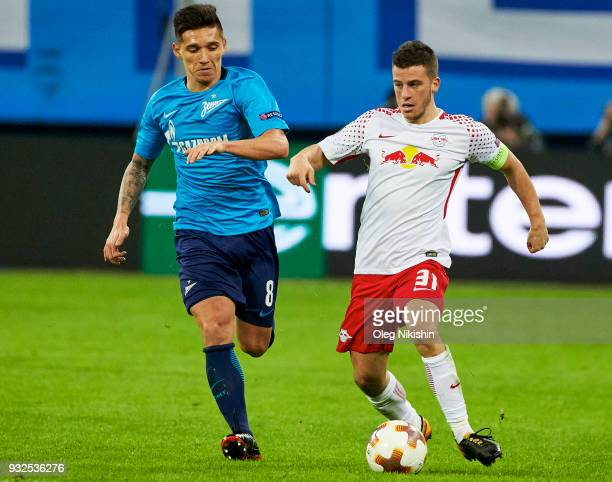 Matias Kranevitter of FC Zenit vies for the ball with Diego Demme of RB Leipzig during UEFA Europa League Round of 16 match between Zenit St...