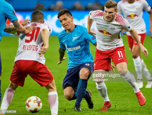 Matias Kranevitter of FC Zenit vies for the ball with Timo Werner and Diego Demme of RB Leipzig during UEFA Europa League Round of 16 match between...