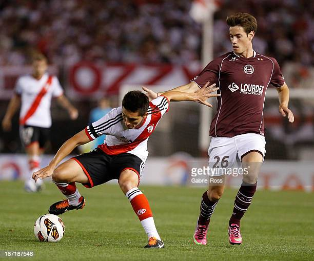 Matias Kranevitter of River Plate fights for the ball with Lucas Melano of Lanus during a match between River Plate and Lanus as part of Copa Total...